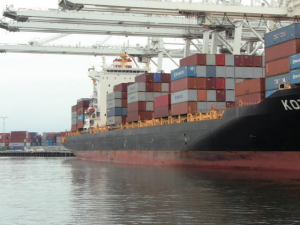 Side view of containers on the ship.